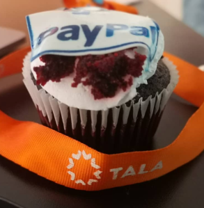 A cupcake with a Paypal logo